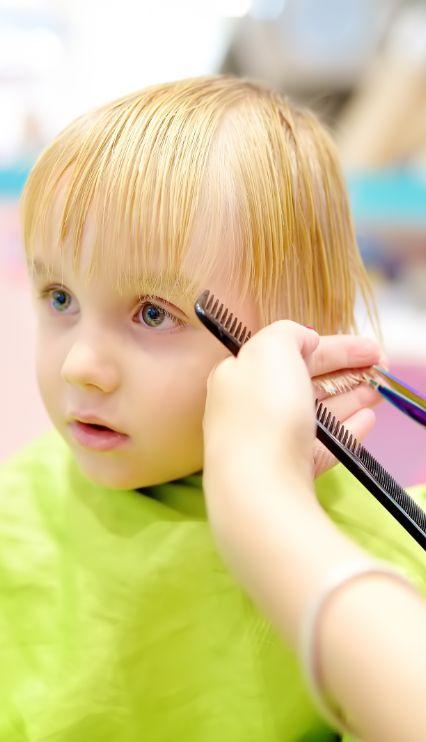 kid getting haircut