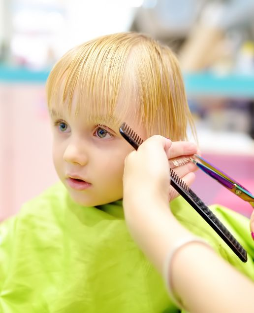 kid getting first haircut