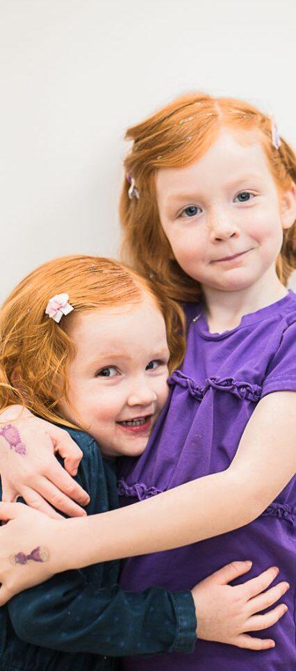 Girls hugging on birthday