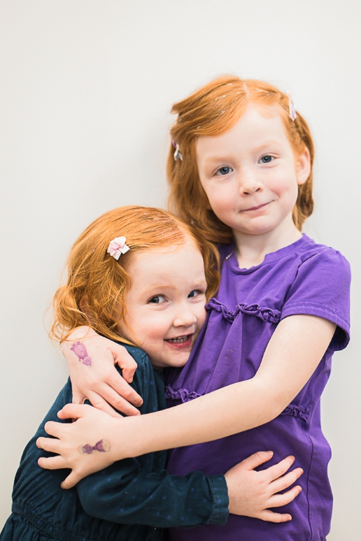 Two kids hugging on a birthday party
